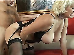 Old tramp in lingerie with floppy breasts fucks a youthfull stud. She sucks his bone and gets a doggystyle internal ejaculation
