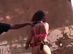 African teen roped and sucks cock outdoors