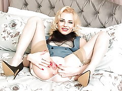 Racy ash-blonde unclothes off retro lingerie finger fucks in nylons