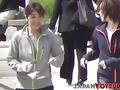 Defined Asian teenagers switch clothes in public