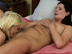 Huge-chested cougar trains young blonde more about lesbian sex