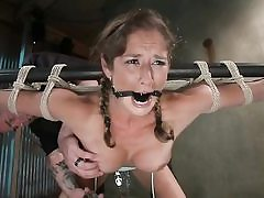Ponytailed bondaged babe gets punished rock-hard