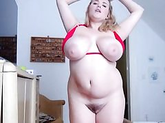 Obese blonde with ample boobs and fat vagina taking off her swimsuit