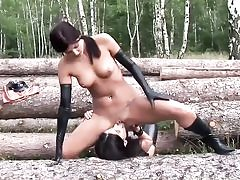 Ultra-kinky tramps wearing latex in the forest and sucking their pussy holes