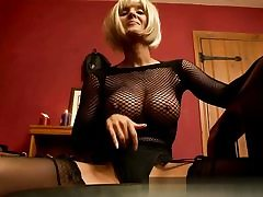 Fabulous light-haired dressed in fishnet and rubbing her wet pussy hole on camera