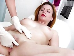 Crazy red haired babe gets her cunt hole examined on a gyno chair