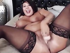 Curvaceous hottie with ample clapping breast plays with a ample fake penis